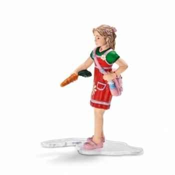 Figurine jeune fille donnant à manger schleich-13905
