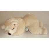 peluche allongee ours polaire 35 cm piutre 2123